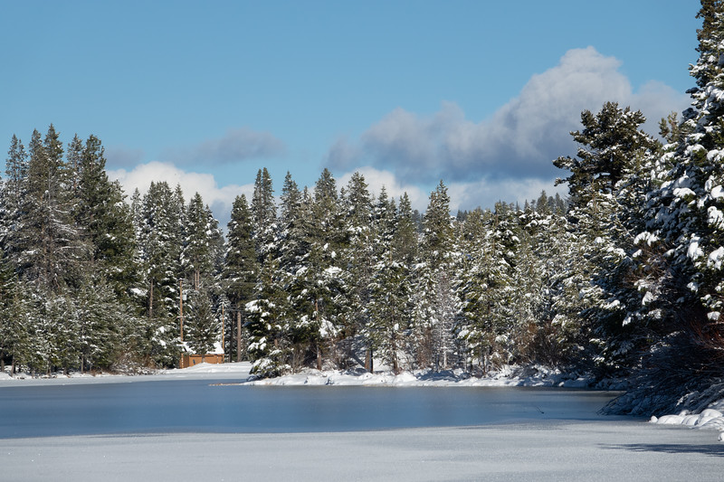 Snow Lined Frozen Small Mountain Lake