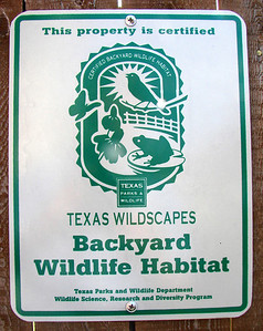 Texas Wildscapes yard sign on gate