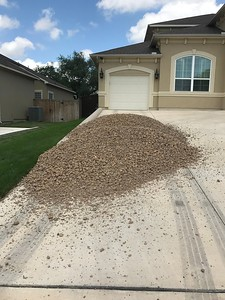 Another view of the 10 tons of gravel & the uphill path to the back yard.