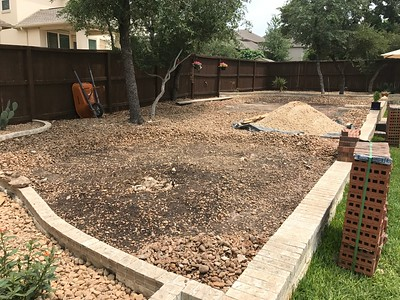 Clearing the existing stone for the fire pit