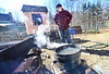 Peter Gould, of Brattleboro, Vt., boils sap for syrup in his backyard on Friday, March 19, 2021.