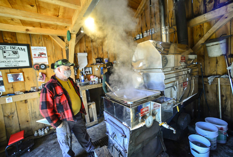Bob Litchfield, of Newfane., Vt., watches as the sap boils during the sugaring process on Monday, March 22, 2021.