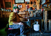 Bob Litchfield, of Newfane., Vt., pours maple syrup into a bottle during the sugaring process on Monday, March 22, 2021.