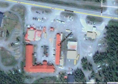 "A satellite view of the Caribou Hotel complex.  The larger ""L"" shape is the main hotel, with the Caribou Restaurant at its north end.  The Annex, the former pipeline construction mancamp, is the long structure, oriented north and south, on the east side."