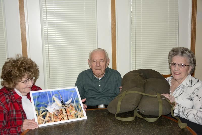 Mel Jacob with women who gathered milkweed pods