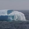 Rough seas breaking against a huge iceberg in Davis Strait