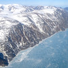 Flying out of Pond Inlet and our pilot treated us to the scenic route along Eclipse Sound and over the camp before flying on to Clyde River.  We could see the iceberg that we had walked around the previous day.