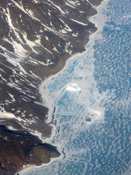 An iceberg lodged in the sea ice east of Pond Inlet