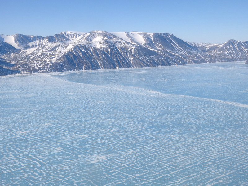 Dramatic Baffin Island scenery and patterns on the sea ice east of Pond Inlet