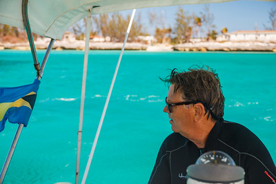 Steve driving the boat in search of green sea turtles