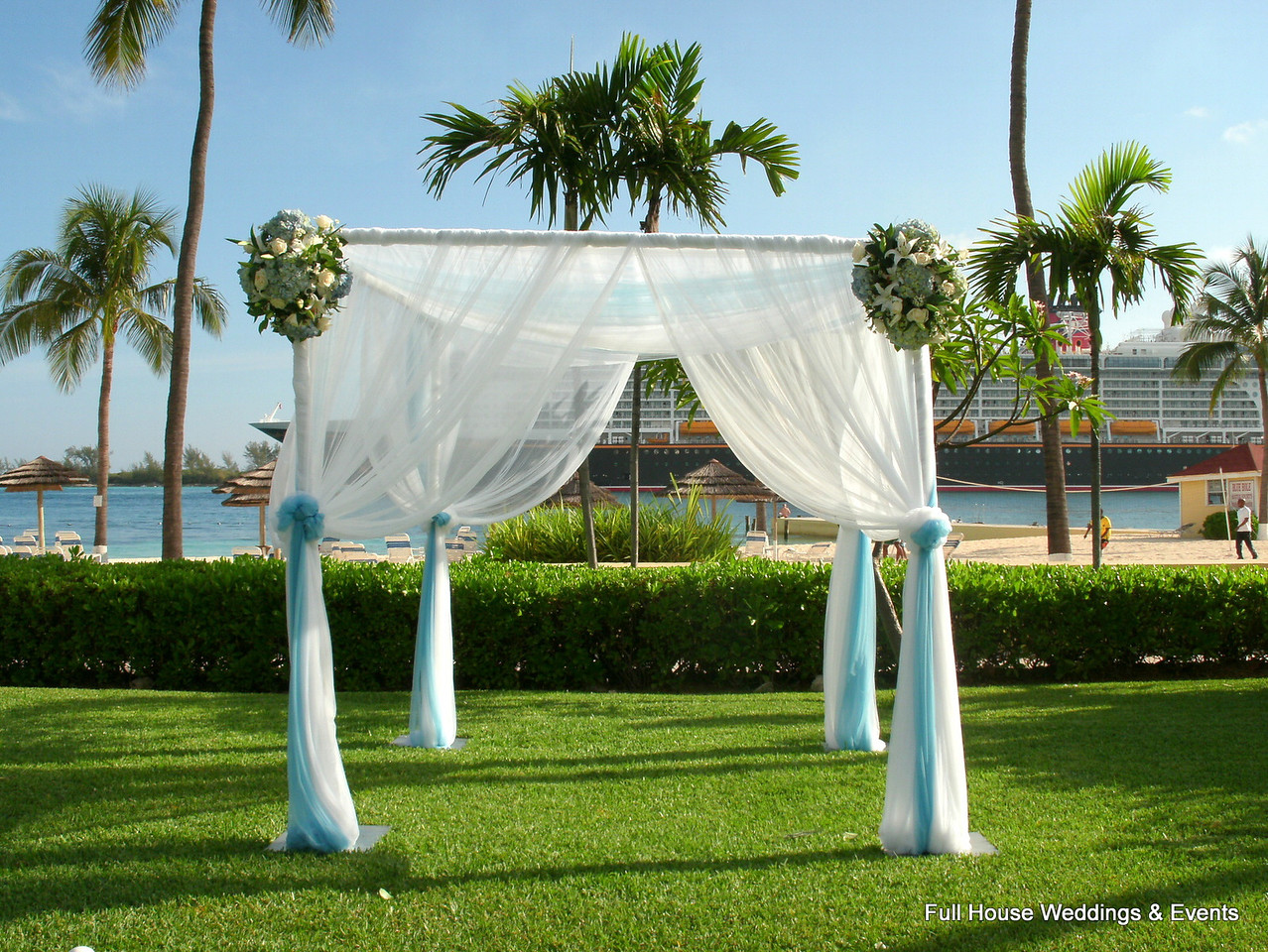 Ceremony Arbor - draped in sheer white and tiffany blue fabric with floral clusters.