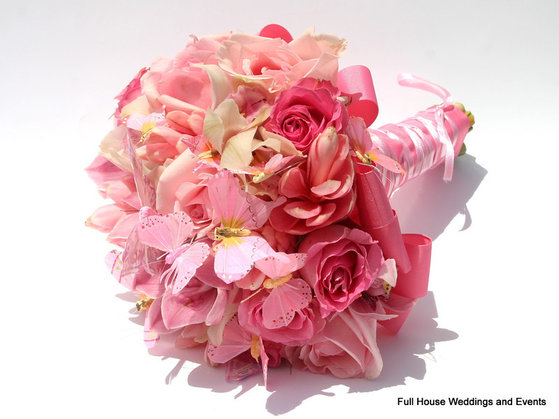Bouquet - Light and medium pink roses, pink tropical ginger, dark pink and white cymbidium orchids accented with assorted pink butterflies.