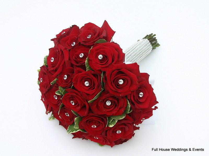 Bouquet - Red Roses accented with pittosporum, diamond pins and rhinestone wrap.