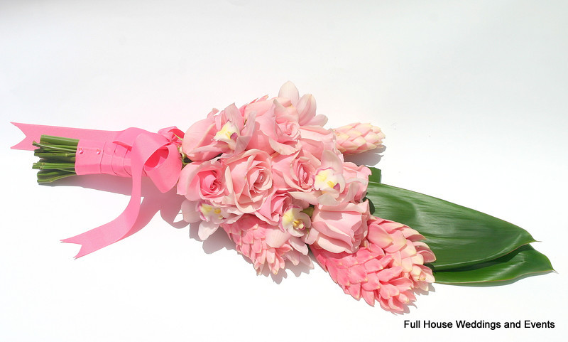 Bouquet - Light Pink Roses, Pink Cymbidium Orchid, Pink Tropical Ginger accented with Tai Leaf (presentation style).