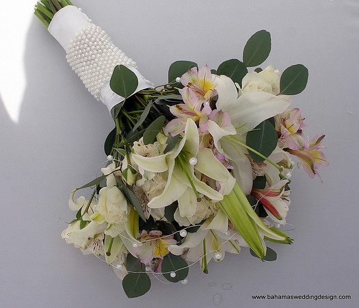 Bouquet - Casablanca Lily, Peruvian Lily, Silver Dollar Eucalyptus with pearl accents and pearl wrap.
