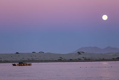 'Moonset' in the morning from Bahía Magdalena near Isla de Magdalena. Baja California Sur, Mexico.