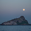 A full moon setting over Isla Todos Santos