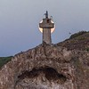 Full moon setting behind the lighthouse on Isla Todos Santos