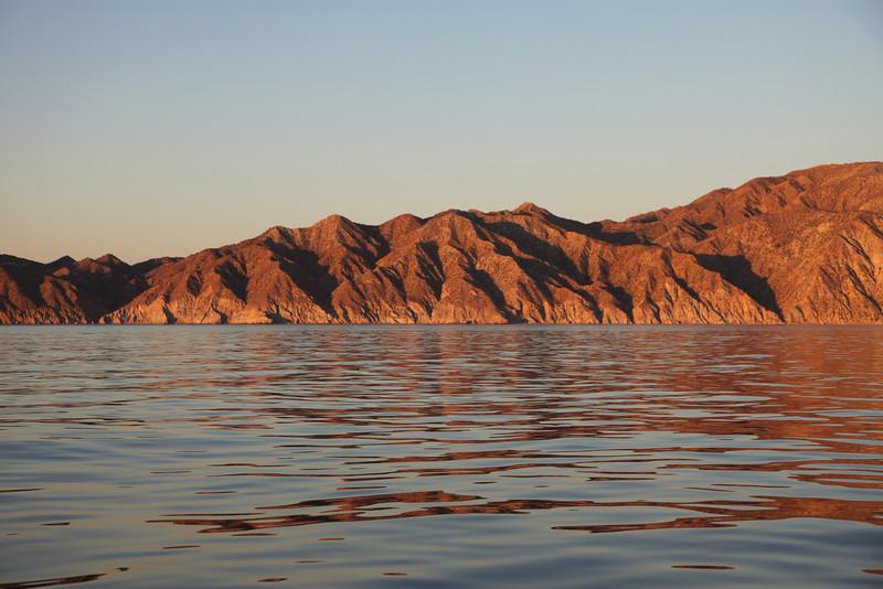 Sunrise illuminating Punta Colorada on Isla San Jose