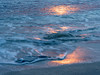 Sunrise Colors Reflected in Water and Sand