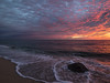 Pink Clouds and Breaking Waves Before Sunrise