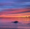 Fiery Pre-dawn Sky  and Half-Submerged Rock