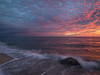 Pink Dawn and Breaking Waves