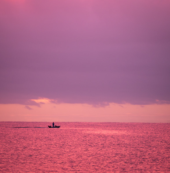 Fisherman and Boat in Silhouette at Dawn