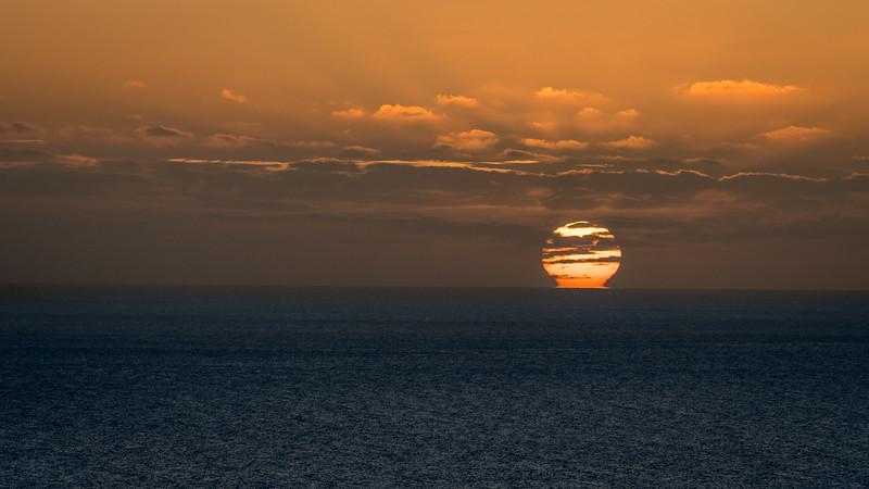 Sun Rising Amid Clouds