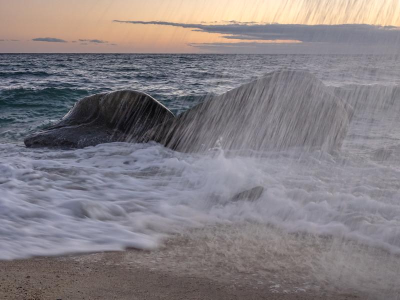 Wave Splash Raining Down on Beach