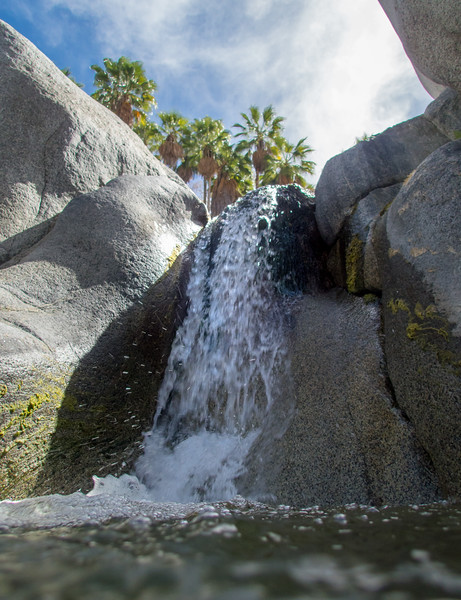 Water-level View of Falls, Granite, and Palm Trees