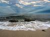 Sun Rays, Rocks, and Surf