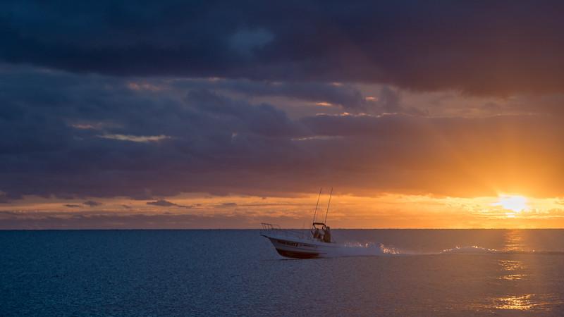 Fishing Boat Heading out at Dawn