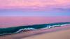 Breaking Waves and Pink Surroundings