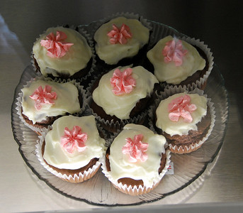 Chocolate cupcakes with pink flowers