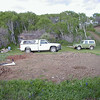 And here is the site with the trailer and shed gone and the holes dug for the foundation piers.