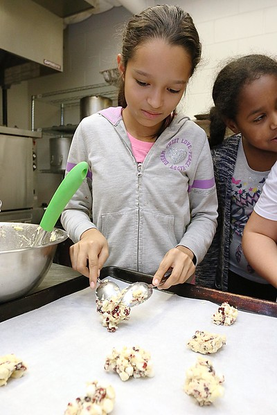 Students at the Boys & Girls Club of North Central MA learned to make winning cranberry chip cookies with Program Instructor Sharon Jorgensen who the students called Chef Sharon. Alineishka Ruiz, 11, from Fitchburg helps shape the mixture they made into balls on a cookie sheet so they could go into the oven. SENTINEL & ENTERPRISE/JOHN LOVE