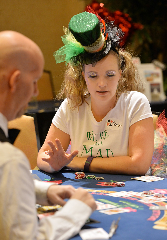 "Katherine Crisler learns about Black Jack from dealer Bryce Keen, left,  during the annual Bal Swan Ball, Saturday, at the Omni Interlocken Resort Hotel.<br /> More photos:  <a href=""http://www.BoCoPreps.com"">http://www.BoCoPreps.com</a><br /> David R. Jennings/Staff Photographer<br /> March 5, 2016"