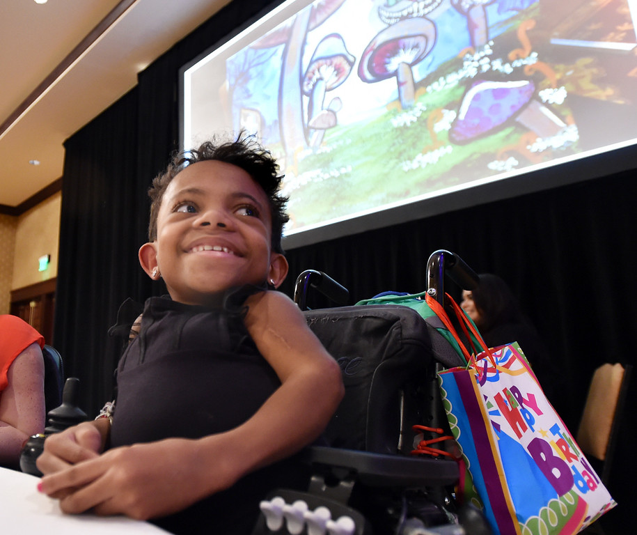 "Anicee Lamoreaux, 12, watches as her painting, projected behind her, is sold for over $3000 at auction during the annual Bal Swan Ball, Saturday, at the Omni Interlocken Resort Hotel.<br /> More photos:  <a href=""http://www.BoCoPreps.com"">http://www.BoCoPreps.com</a><br /> David R. Jennings/Staff Photographer<br /> March 5, 2016"