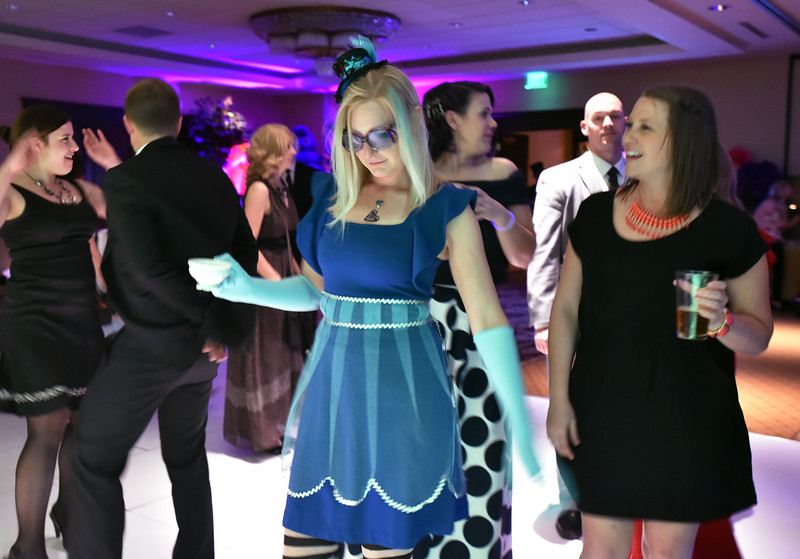"Bal Swan teacher Janet Gonzalez as Alice with tea cup in hand dances during the annual Bal Swan Ball, Saturday, at the Omni Interlocken Resort Hotel.<br /> More photos:  <a href=""http://www.BoCoPreps.com"">http://www.BoCoPreps.com</a><br /> David R. Jennings/Staff Photographer<br /> March 5, 2016"