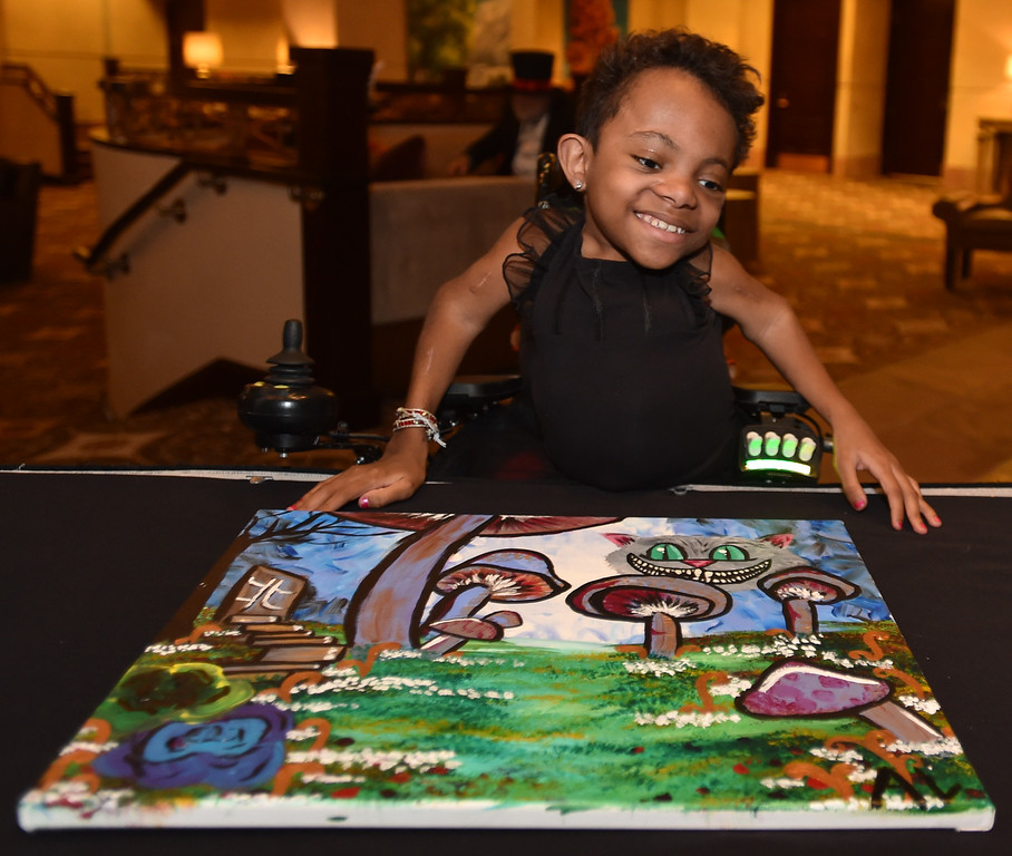 "Anicee Lamoreaux, 12, shows her painting that was sold for over $3000 at auction during the annual Bal Swan Ball, Saturday, at the Omni Interlocken Resort Hotel.<br /> More photos:  <a href=""http://www.BoCoPreps.com"">http://www.BoCoPreps.com</a><br /> David R. Jennings/Staff Photographer<br /> March 5, 2016"