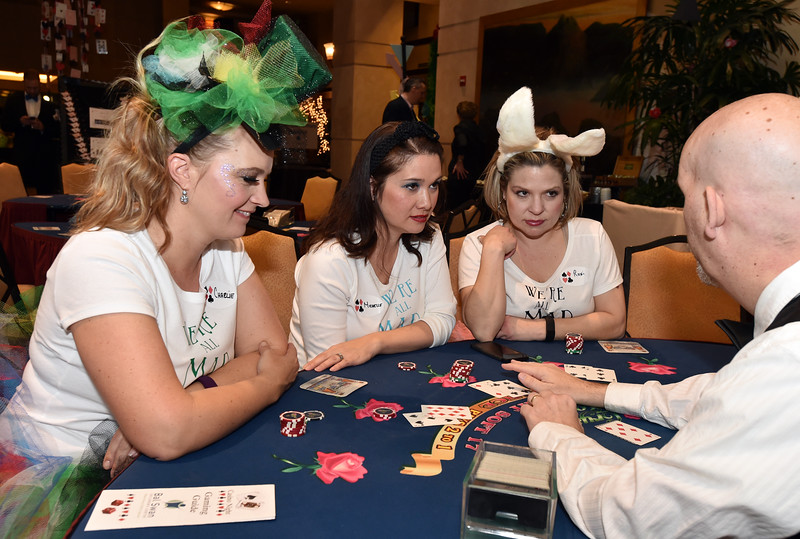 "Katherine Crisler, left, Michelle Ingle and Jax Jaramillo are taught about Black Jack from dealer Bryce Keen during the annual Bal Swan Ball, Saturday, at the Omni Interlocken Resort Hotel.<br /> More photos:  <a href=""http://www.BoCoPreps.com"">http://www.BoCoPreps.com</a><br /> David R. Jennings/Staff Photographer<br /> March 5, 2016"
