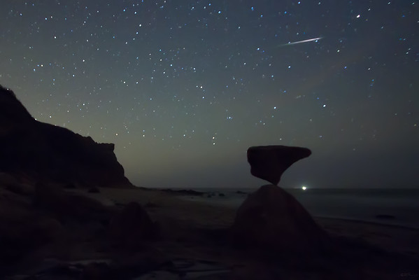 Block Island Balance 14  - 220 pound boulder balanced at Corn Cove, Mohegan Bluffs, Block Island, RI, with meteor. March, 2012.