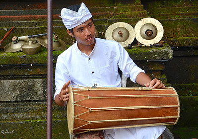 Playing traditional drums the Kendang