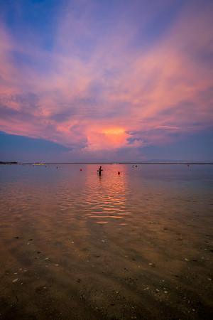 Fishing at Nusa Dua Beach at sunset.