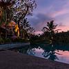 Mandapa Reserve Poolside at sunset.