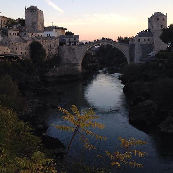 Stari Most, the Old Bridge of Mostar, at sunset.