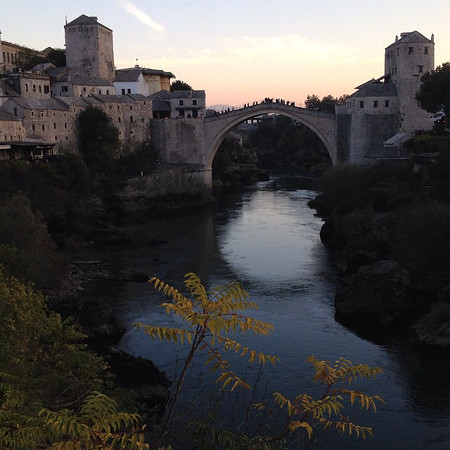 Stari Most, the Old Bridge of Mostar, at sunset.