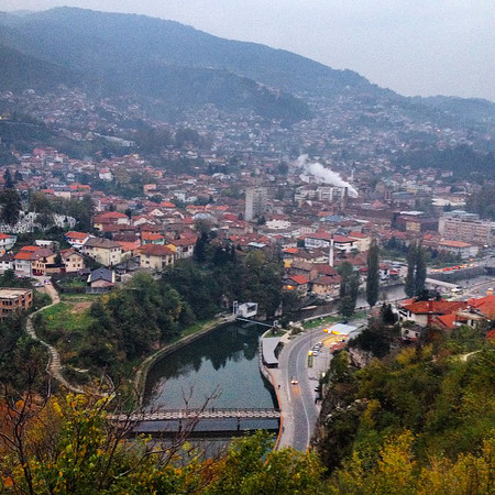 Sarajevo, at the bend of the Miljacka River. A city that has known so many lives in its history including more recently the spark of WWI, the '84 Winter Olympics and The Siege. This, a view from the Yellow Fortress atop Kovači. via Instagram http://ift.tt/1o2e5Mp