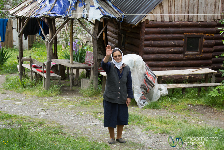 Grandmother Waves Goodbye at Homestay in Cerem, Albania